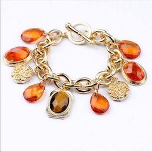 Beautiful orange gems gold charms bracelet!